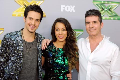 "Singers Alex (L) and Sierra, with executive producer Simon Cowell (R) pose backstage after winning season three at Fox's ""The X Factor"" Season Finale at CBS Television City on December 19, 2013 in Los Angeles, California."