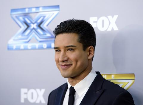 "Host Mario Lopez poses backstage after ""The X Factor"" finale in Los Angeles, California, December 19, 2013. Winners Alex Kinsey and Sierra Deaton won a $1 million recording contract with Sony Music Entertainment."