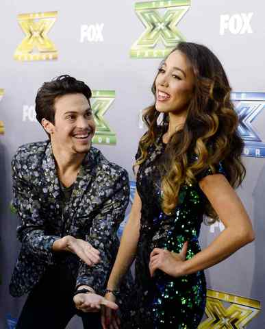 "Alex Kinsey (L) and Sierra Deaton pose backstage after the folk duo won ""The X Factor"" in Los Angeles, California, December 19, 2013. Winners Kinsey and Deaton won a $1 million recording contract with Sony Music Entertainment."