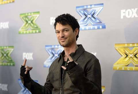 "Finalist Jeff Gutt poses backstage after ""The X Factor"" finale in Los Angeles, California, December 19, 2013. Winners Alex Kinsey and Sierra Deaton won a $1 million recording contract with Sony Music Entertainment."
