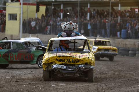 A driver takes part in a demolition derby organised by the Malta Motor Sports Association to raise funds for charity in Ta' Qali, outside Valletta, December 22, 2013. The drivers have one ultimate aim - that their vehicle, or what's left of it, remains the only one standing.