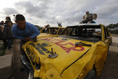 A driver prepares his car for a demolition derby organised by the Malta Motor Sports Association to raise funds for charity in Ta' Qali, outside Valletta, December 22, 2013. The drivers have one ultimate aim - that their vehicle, or what's left of it, remains the only one standing.