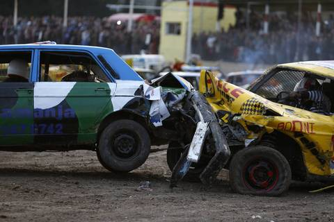 Drivers take part in a demolition derby organised by the Malta Motor Sports Association to raise funds for charity in Ta' Qali, outside Valletta, December 22, 2013. The drivers have one ultimate aim - that their vehicle, or what's left of it, remains the only one standing.