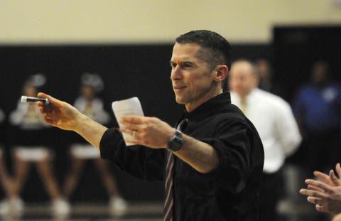 East Catholic High School's head coach, Luke Reilly, reacts to a play during the second quarter.