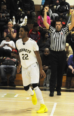 East Hartford High School's, Kahari Beaufort, 22, reacts after hitting a three point shot during the second quarter.