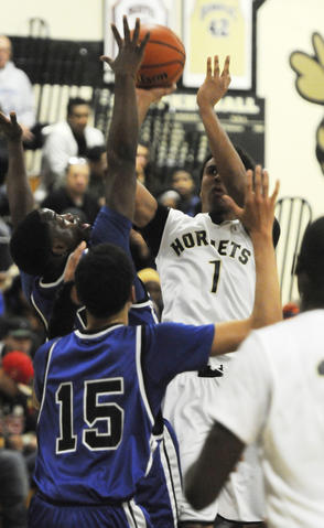 East Hartford High School's, Devin Marsh, 1, takes a shot during the second quarter.
