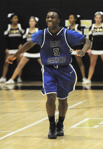 East Catholic High School guard, Winston Morgan, 5, reacts after his team expands their lead in the fourth period.