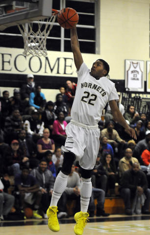 East Hartford High School's, Kahari Beaufort, 22, scores two points on this dunk during the second quarter.