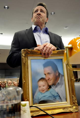 "HARTFORD 01/28/13 Neil Heslin holds a framed photograph of him and his son Jesse when Jesse was a baby while appearing at a hearing of the legislature's Bipartisan Task Force On Gun Violence Prevention and Children's Safety at the legislative office building Monday.  Jesse, 6, was one of the twenty children killed in the Sandy Hook massacre.  ""Jesse was my buddy and my best friend,"" said Heslin."