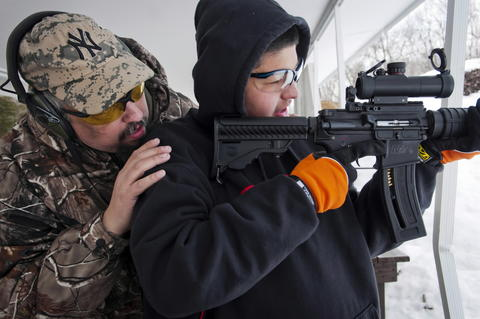 02.20.2013 - Berlin, CT - Jonathan Hardy and his son Bredan, 15, target shoot their AR-15 assault rifles at the Mattabasset Rifle and Pistol Club.