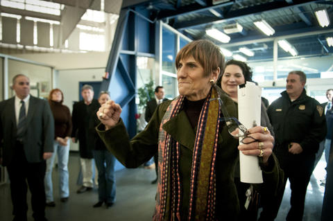 03.01.2013 - New Haven, CT - Fists raised, U.S. Representative Rosa DeLauro enters Tweed-New Haven Airport for a press conference with U.S. Senators Richard Blumenthal and Chris Murphy, U.S. Rep Rosa DeLauro and New Haven Mayor John DeStefano at Tweed-New Haven Airport to discuss the impact sequestration will have on jobs and the economy. Tweed, said Blumenthal, is one of 200 airports in the country on a list for closing due to sequestration.
