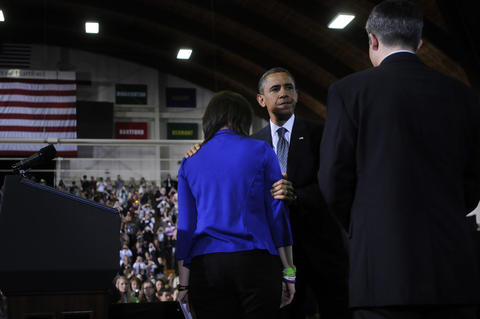 West Hartford, CT 4/8/2013 President Barack Obama hugs Nicole Hockley, after she introduced him. She and her husband, Ian, at right, lost their son Dylan in the Sandy Hook Shooting. Obama spoke at the Chase Family Arena at the University of Hartford to push his efforts for new legislation to address gun violence. This is Obama's second visit to Connecticut since the Newtown shootings, and first visit since Gov. Dannel Malloy and the Conn. legislature passed strong new gun legislation.