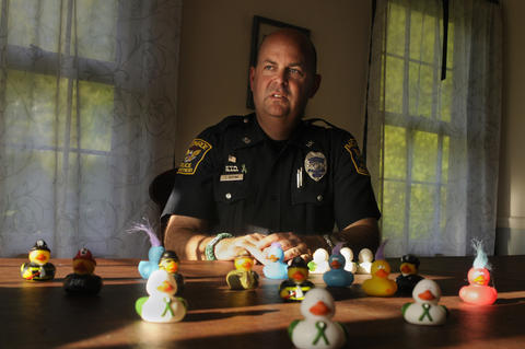 Newtown CT 5/14/2013 Monroe Police Officer Todd Keeping has been patrolling the halls of Chalk Hill Elementary School since it opened as the new Sandy Hook School in January. Keeping, who lives in Sandy Hook, requested the assignment. As the school opened, he and other officers started to hand out rubber ducks that were donated to the school. The ducks have since served to ease the tension and become a major phenomena in town. The kids love them. A Facebook page has about 10,000 likes and they have photos of the ducks with President Obama, Gov. Malloy, and in places all around the world.