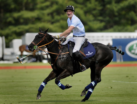 GREENWICH 5/15/13-Prince Harry shouts to a teammate on the field at the Sentebale Royal Salute Polo Cup at the Greenwich Polo Club Wednesday.