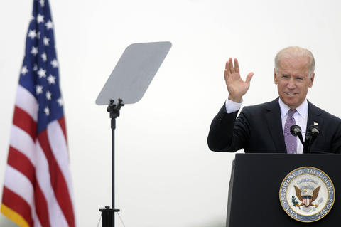 NEW LONDON 05/22/13 Vice President Joe Biden waves to the cadets and families at the U.S. Coast Guard Academy's 132nd commencement in New London Wednesday.