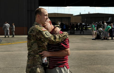 tEast Granby, CT  6/05/13  It's never too late for a hug from your father as Adam Avenia of the 143rd Military Police Company of the Connecticut National Guard welcomes his father John into his arms on his return from Afghanistan Wednesday to the Air National Guard base near Bradley Airport. Traffic held John up as he traveled from Ansonia where they both live but it was worth the wait as they embraced.