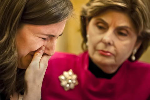 2013.10.21 - Hartford, CT - Accompanied by attorney Gloria Allred (R), University of Connecticut graduate Kylie Angell cries during a press conference while talking about being raped by a classmate. Angell, is one of seven current and/or former University of Connecticut students represented by Allred who has filed a complaint with the Office of Civil Rights claiming the students' rights under Title IX have been violated by UConn.