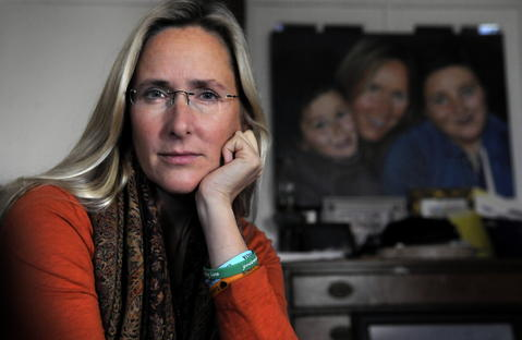 Sandy Hook, CT  10/24/13  Scarlett Lewis, the mother of Jesse Lewis, the Sandy Hook first grader shot and killed by Adam Lanza after telling his classmates to run has writen a book, the first Sandy Hook parent to do so. Lewis sits in her Sandy Hook home where a painting of her with Jesse and her older son J.T. hangs in the living room.
