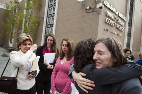 2013.11.01 - Hartford, CT - (L-R) Connecticut attorney Nina Pirrotti hugs UConn student Kyli Angell outside court today where Gloria Allred (far left) filed a lawsuit against the Univeristy of Connecticut alleging that UConn has violated the rights under Title IX of (second from left to right) of Carolyn Luby, Erica Daniels and Angell. Allred, who does not have a license to practice law in Connecticut, is seeking the court's permission to co-counsel the case with Pirrotti.