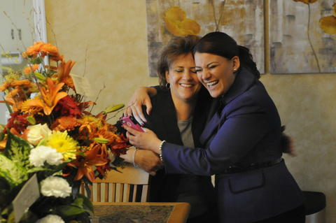 New Britain, CT 11/6/2013 New Britain's new Mayor, Erin Stewart, gives her mother, Patty, a hug after stopping by her house Wednesday afternoon, to open letters and flowers from well wishers. The day after winning the New Britain Mayoral election,  Stewart, is working toward preparing for her inauguration next week. Stewart, twenty-six, follows a family tradition as her father, Tim Stewart, also served as the Mayor of New Britain.