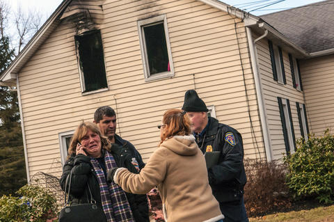 "2013.12.04 -Somers, Ct - With (L-R) Glen Reynolds of the Somers Fire Department, friend Lori-Anne Davis, and Robert Morpurgo (R) of the Somers Fire Department, Karen Harvey (L), makes a call from outside the home where her daughter, Katie Colgan, 33, and granddaughter Kerra Colgan, was inside when it caught fire early this morning.  Both victims were taken to Bay State Hospital in Springfield. But Harvey said Kerra Colgan was transferred to Shriners Hospital for Children in Boston and Katie Colgan was transferred to Massachusetts General Hospital.   Somers Deputy Fire Chief Frank Falcone said a passerby went into the house and rescued the 7-year-old girl. Firefighters rescued a semi-conscious woman in her 30's on the second floor, where they believe the fire started.  Harvey asked for the passerby who rescued her granddaughter to come forward.  ""Whoever you are I want to thank you from the bottom of my heart. Thank you so very much. Please come forward so we know who you are so I can thank you personally for saving my daughter's life and my granddaughter's life,"" she said."