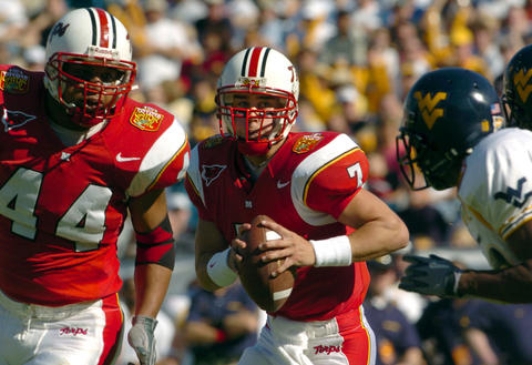 Terps quarterback Scott McBrien follows his blocker Jeris Smith to rush for yardage during the first quarter.