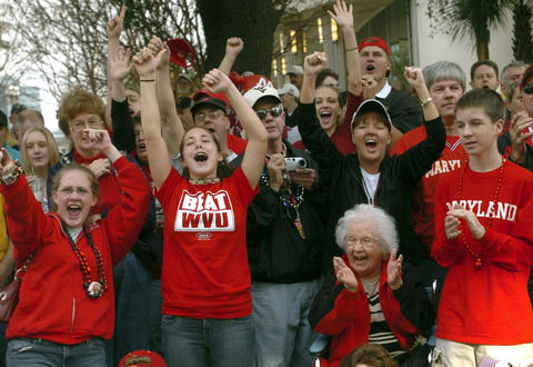 Terps fans cheer at the Gator Bowl Parade held in downtown Jacksonville the day before the game.