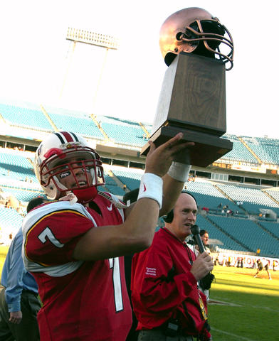 Maryland quarterback Scott McBrien hoists the MVP trophy.