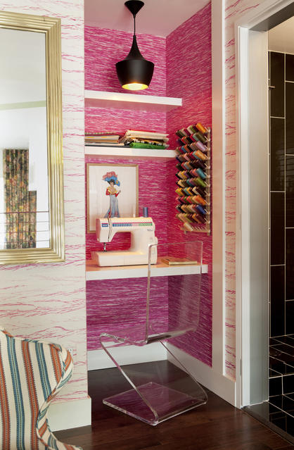 Designer Molly Luetkemeyer transformed a tiny closet into a sewing space in the mezzanine of the Small Space Big Style design house in Hollywood. The walls are lined with contrasting pink grass cloth from Elitis.