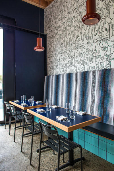 At the Superba Snack Bar in Venice, designers Rebecca Rudolph and Cathy Johnson lined a wall with a custom run of Geoff McFetridge wallpaper from Pottok Prints. The pattern -- holding hands -- furthers the community theme of the restaurant. Photo gallery.
