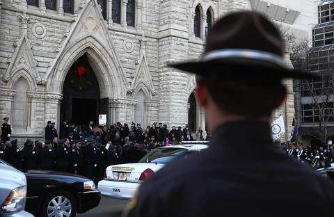 A crowd lines up outside the funeral service for Cook County sheriff's officer Cuauhtemoc Estrada at Holy Name Cathedral.