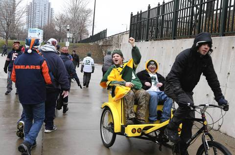 Green Bay Packers fans arrive at Soldier Field before the game.