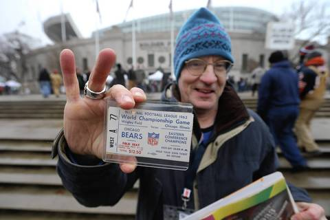 Jim Zangrilli, of Oak Park, shows off his original ticket for the 1963 Chicago Bears championship game against the New York Giants, at Wrigley Field. The ticket price was $12.50.