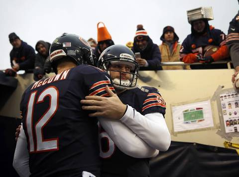 Chicago Bears' Jay Cutler and Josh McCown embrace before heading out to the field before playing the Green Bay Packers at Soldier Field.