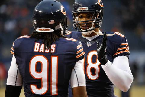 Chicago Bears defensive tackle Corey Wootton (98) chats with Chicago Bears defensive end David Bass (91) during pre-game warm ups before facing the Green Bay Packers at Soldier Fiel.
