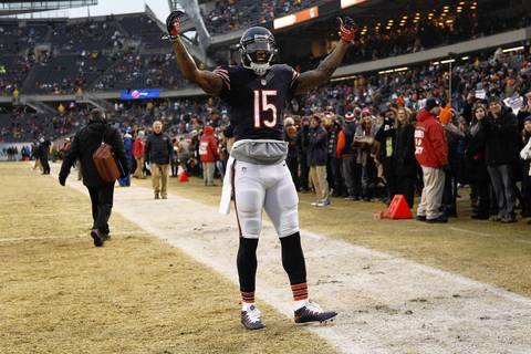 Chicago Bears wide receiver Brandon Marshall (15) gets the crowd going during pre-game warm ups before facing the Green Bay Packers at Soldier Field.