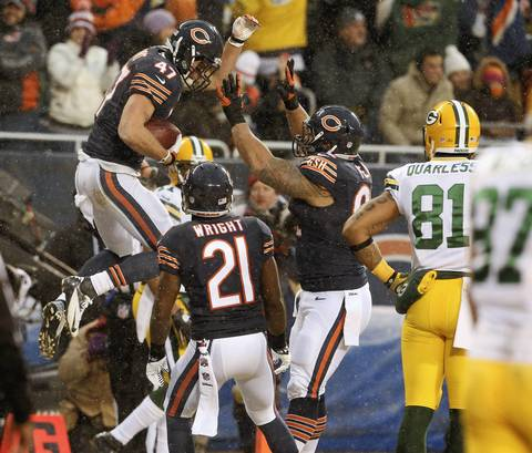 Chicago Bears free safety Chris Conte (47), celebrates his interception with teammates Major Wright (21), and Stephen Paea (92), during the first quarter against the Green Bay Packers at Soldier Field.
