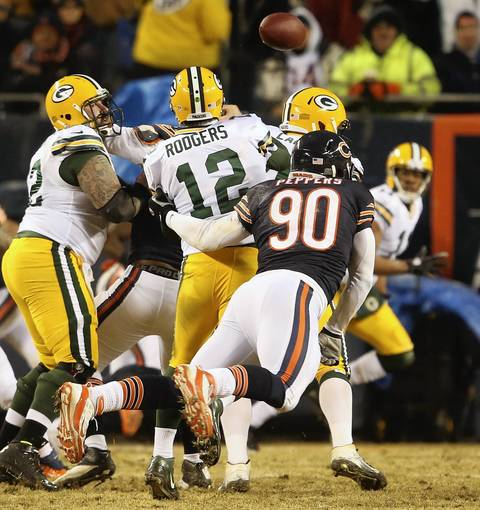 Chicago Bears defensive end Julius Peppers (90), forces Green Bay Packers quarterback Aaron Rodgers (12) to fumble, which resulted in a Green Bay touchdown.