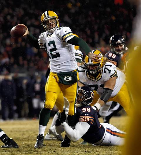 Chicago Bears' Corey Wootton pressures Green Bay Packers' quarterback Aaron Rodgers in the 2nd quarter at Soldier Field.