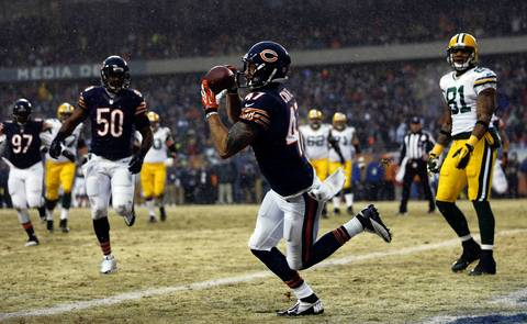 Chicago Bears' Chris Conte intercepts a 1st quarter pass by Green Bay Packers' Aaron Rodgers during the first quarter.