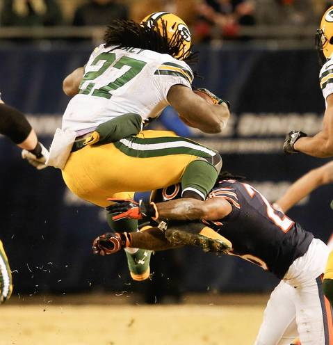 Chicago Bears cornerback Tim Jennings (26) runs into a leaping Green Bay Packers running back Eddie Lacy (27), during the second quarter at Soldier Field.