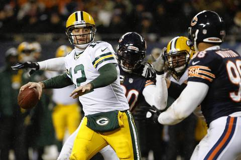 Chicago Bears defensive end Julius Peppers (90) applies the pass rush on Green Bay Packers quarterback Aaron Rodgers.