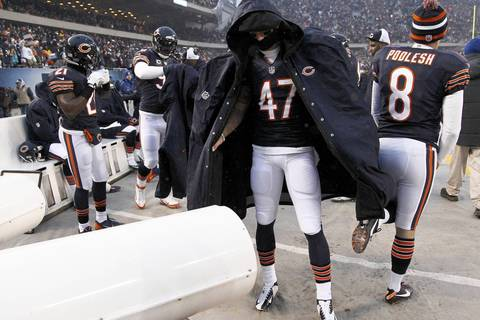 Chicago Bears free safety Chris Conte (47) tries to stay warm before the start of a game against the Green Bay Packers at Soldier Field.