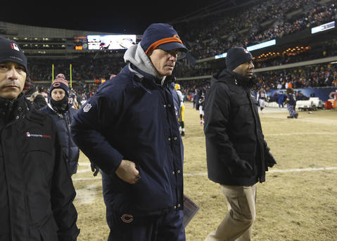 Bears coach Marc Trestman leaves the field following his team's loss.