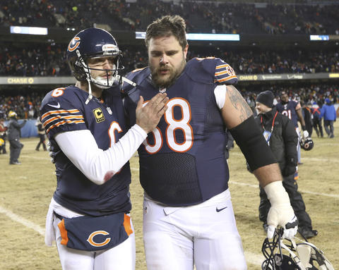 Jay Cutler with guard Matt Slauson at the end of their team's loss to the Packers at Soldier Field.