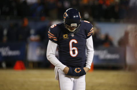 Jay Cutler hangs his head down after the final play of the game.