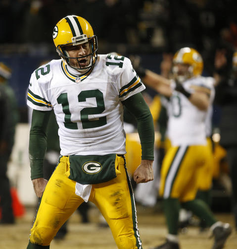 Packers quarterback Aaron Rodgers reacts after he throws the game-winning touchdown to Randall Cobb in the fourth quarter.