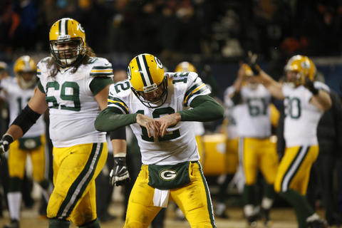 Packers quarterback Aaron Rodgers reacts after he throws the game-winning touchdown to wide receiver Randall Cobb in the fourth quarter.