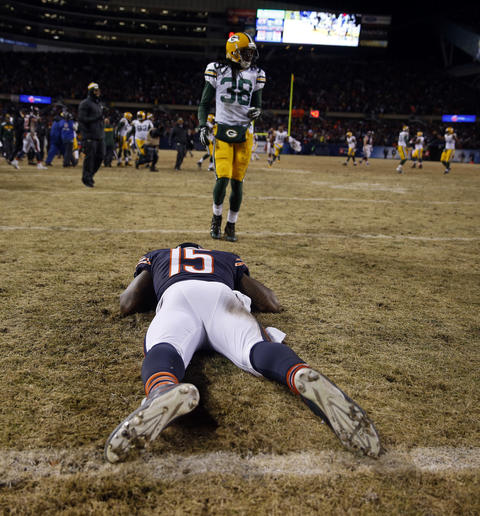 Brandon Marshall lies on the turf at end of 33-28 loss to the Packers.