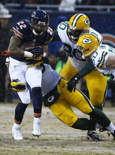 Chicago Bears running back Matt Forte (22) runs as the Green Bay Packers defense make the tackle in the first quarter at Soldier Field.